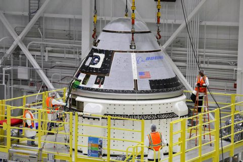 The crew module of Boeing's CST-100 Starliner spacecraft is lifted onto its service module on Oct. 16 inside the Commercial Crew and Cargo Processing Facility (C3PF) at Kennedy Space Center in Florida ahead of the company's Orbital Flight Test to the International Space Station as part of NASA's Commercial Crew Program. (Boeing)