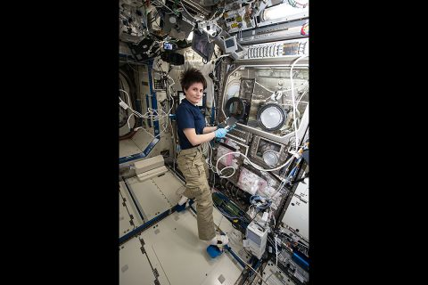 ESA (European Space Agency) astronaut Samantha Cristoforetti working on the 3D Printer aboard the space station. (NASA)