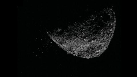 This view of asteroid Bennu ejecting particles from its surface on Jan. 6, 2019, was created by combining two images taken by the NavCam 1 imager aboard NASA's OSIRIS-REx spacecraft: a short exposure image, which shows the asteroid clearly, and a long-exposure image (five seconds), which shows the particles clearly. (NASA/Goddard/University of Arizona/Lockheed Martin)