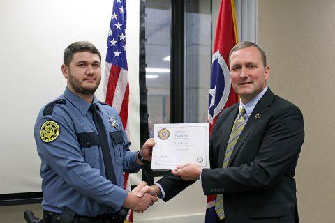 Montgomery County Sheriff John Fuson congratulates Tyler Waugh.