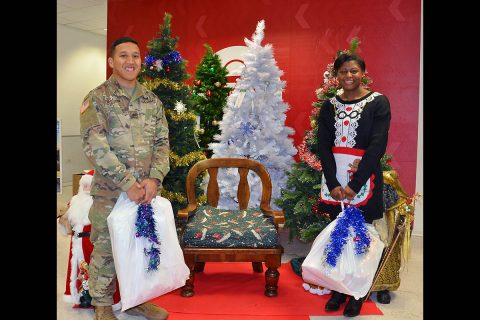 For the sixth consecutive year, an unknown person or persons paid off Vicenza-based Soldier and family Exchange layaway accounts without warning. Army Sgt. Bailon Batalion (left) and Tranika Floyd picked up their Christmas layaway holiday gifts at the main Exchange store in Vicenza, Italy on Thursday, December 19th. (Laura Kreider, U.S. Army Garrison Italy)