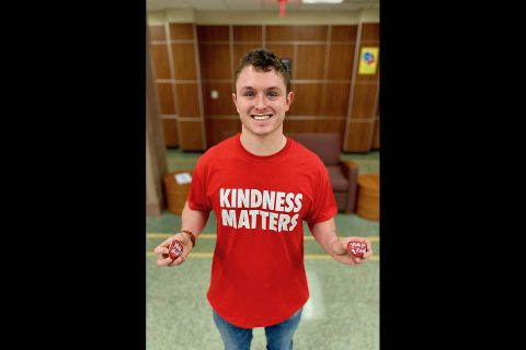 Austin Peay State University student Blake Burch holds two of the civility rocks. (APSU)