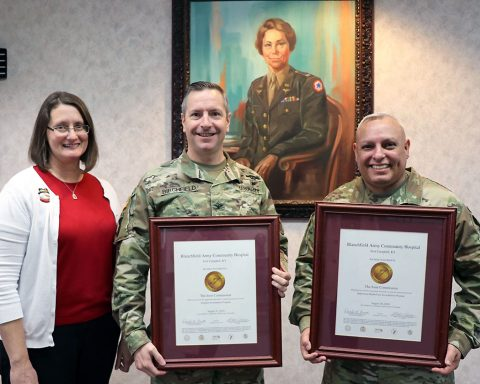 BACH Accreditation Manager, Ms. Quetta Beck, Hospital Commander, Col. Patrick T. Birchfield, and Hospital Command Sergeant Major, Command Sgt. Maj. Daniel Santiago, proudly display the hospital's Gold Seals of Approval from The Joint Commission. The Joint Commission accredits and certifies more than 22,000 health care organizations and programs in the United States.  (U.S. Army photo by Maria Yager)