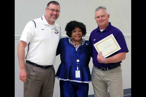 Clarksville High School principal Bryan Feldman stands with School Board member Carol Berry and Coach Brian Hetland.