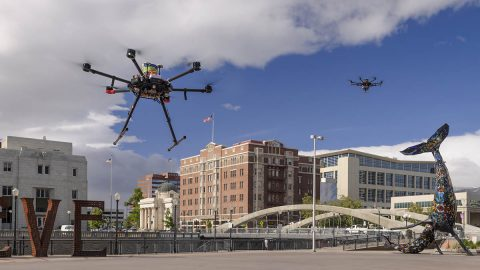 Drones in flight in downtown Reno, Nevada, during shakedown tests for NASA's Unmanned Aircraft Systems Traffic Management project, or UTM. The final phase of flight tests, known as Technical Capability Level 4, took place from May through August 2019 and studied how the UTM system could integrate drones into urban areas. (NASA/Dominic Hart)