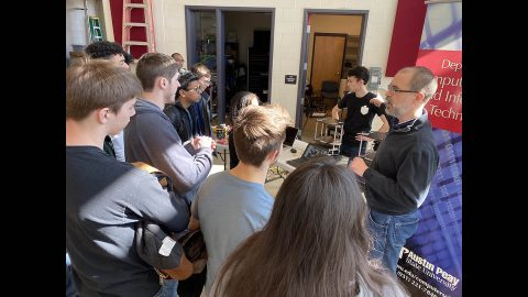 Austin Peay State University students show off robotic manufacturing systems and robots to Northeast High School students. (APSU)