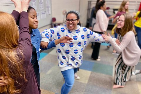 West Creek Middle students laugh as they try to choreograph a dance. (APSU)
