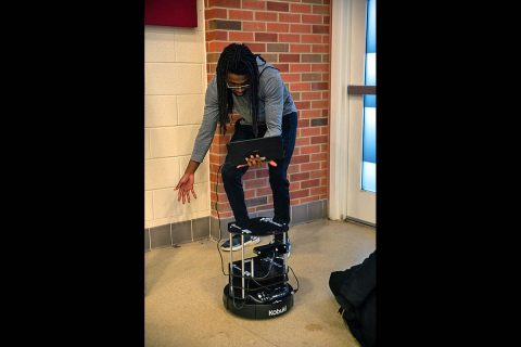 Austin Peay State University student Isaiah Carmichael tests the computer vision of a TurtleBot II. (APSU)