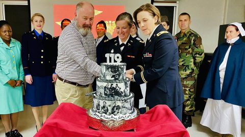 BACH's most senior nurse, Mr. Jim NIx, Deputy to the Commander for Quality and Safety, and most junior nurse 1st Lt. Kathryn Fullman, join Col. Amanda Forristal, Deputy Commander for Nursing, to cut a cake celebrating the 119th anniversary of the Army Nurse Corps. (U.S. Army photo)