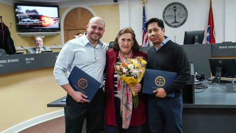 Ingeborg Johnson is flanked by Flumencio Brinkley and Sergio Carrillo, who were honored for bravely removing Johnson from a wrecked vehicle just as it burst into flames. The three gathered for a happy reunion at Thursday's City Council meeting.
