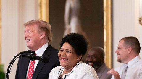 President Donald Trump congratulates former inmates who benefited from the First Step Act at the 2019 White House Prison Reform Summit.