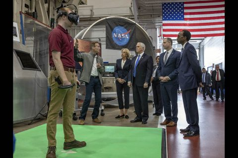 Pat Troutman, space architect, second from left, shows off how Langley is using virtual reality to plan Moon and Mars missions. Looking on from the right is Clayton Turner, Langley center director; Jim Bridenstine, NASA administrator; Vanessa Wyche, deputy director NASA's Johnson Space Center; Vice President Mike Pence; and Betsy Davos, education secretary. (NASA/David C. Bowman)
