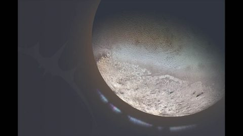 The proposed Trident mission would explore Neptune's moon Triton, seen here in a global color mosaic with an artist's concept of an ionosphere. (NASA/JPL-Caltech)