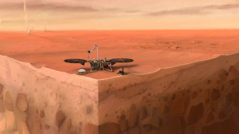 In this artist's concept of NASA's InSight lander on Mars, layers of the planet's subsurface can be seen below and dust devils can be seen in the background. (IPGP/Nicolas Sarter)