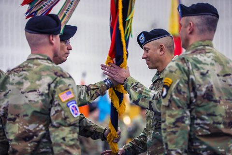 Command Sgt. Maj. Gabelmann, senior enlisted advisor, 1st Brigade Combat Team, 101st Airborne Division (Air Assault) is handed the brigade colors on finale time March 3 during a change of responsibility ceremony in Sabo Physical Fitness Center on Fort Campbell, KY. This will be Gabelmann's last change of responsibility as he is set to retire later this year bringing 3 decades of service to an end. (U.S. Army photo by Sgt. James Griffin)