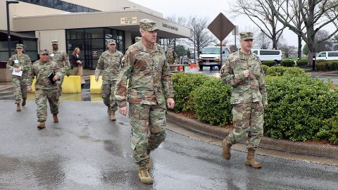 BACH Commander Col. Patrick T. Birchfield (right) leads 101st Airborne Division (Air Assault) and Fort Campbell Commanding General, Maj. Gen. Brian Winski (left) to a drive-up clinic established outside the hospital where medical staff are seeing patients referred for possible coronavirus, COVID-19 related symptoms. The general visited BACH for a first-hand look at the hospital's many preparations to respond to the coronavirus, COVID-19 pandemic. (U.S. Army photo by Maria Yager)