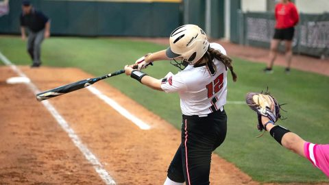 Austin Peay State University Softball junior #12 Brooke Pfefferle hits a single in the bottom of the 10th to score #6 junior Bailey Shorter for 3-2 win over Bradley. (APSU Sports Information)