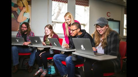 Austin Peay State University students with laptops provided by APSU so they can do courses online. (APSU)