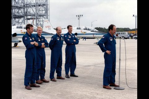 The STS-26 Discovery crew arrive at the Kennedy Space Center in 1988 for the Return to Flight mission following the 1986 Challenger disaster. After it was retired in 2011, the T-38 jet with the tail number of 912 provided NASA's X-59 QueSST with parts of its landing gear. (NASA)