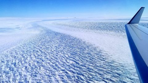 This photograph shows ripples in the surface of Denman Glacier in East Antarctica that throw shadows against the ice. The glacier is melting at a faster rate now than it was from 2003 to 2008. (NASA)