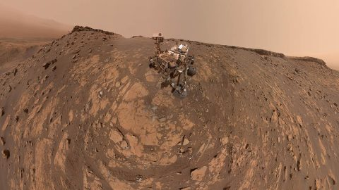 """This selfie was taken by NASA's Curiosity Mars rover on Feb. 26, 2020 (the 2,687th Martian day, or sol, of the mission). The crumbling rock layer at the top of the image is """"the Greenheugh Pediment,"""" which Curiosity climbed soon after taking the image. (NASA/JPL-Caltech/MSSS)"""