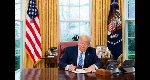 President Donald Trump signs a Presidential Memorandum on making general use face masks available to our healthcare workers. (White House)