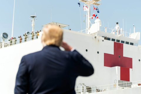 President Trump salutes the USNS Comfort as she departs Naval Air Station Norfolk Pier 8 in Virginia en route to New York City. (White House)