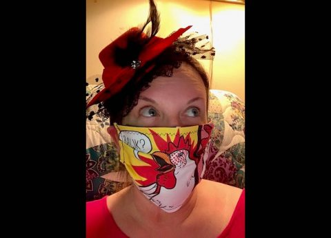 Austin Peay State University Professor Leni Dyer models one of the masks she made herself, inspired by pop artist Roy Lichtenstein. (APSU)