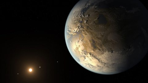 This artist's concept depicts Kepler-186f, the first confirmed Earth-sized exoplanet that may host liquid water on its surface and a candidate for further study. (NASA Ames/SETI Institute/JPL-Caltech)