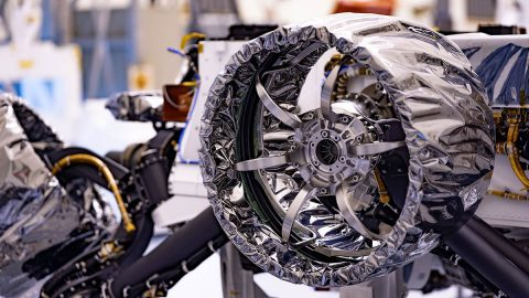 This wheel, and five others just like it, heads to Mars on NASA's Perseverance rover this summer. Wrapped in a protective antistatic foil that will be removed before launch, the wheel is 20.7 inches (52.6 centimeters) in diameter. The image was taken on March 30, 2020, at NASA's Kennedy Space Center. (NASA/JPL-Caltech)