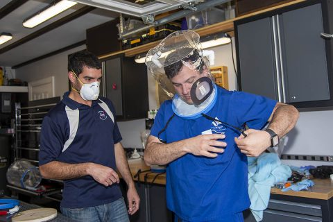 NASA engineer Mike Buttigieg works on an oxygen hood system prototype worn by Dr. Daniel Khodabakhsh from the Antelope Valley Hospital in California. The hood is designed to help coronavirus patients who don't yet need a ventilator, but who are experiencing breathing troubles. The hood forces oxygen into patients with mild coronavirus symptoms, minimizing the likelihood that the patient will need to use a ventilator. (NASA/Carla Thomas)