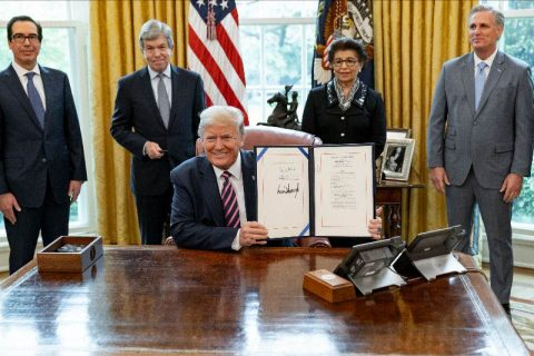 President Donald Trump signs H.R. 266, the Paycheck Protection Program and Health Care Enhancement Act. (White House)