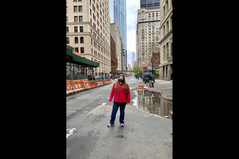 Austin Peay State University nursing student Sarah Sullivan stands on an abandoned street near the new World Trade Center (in background). (APSU)