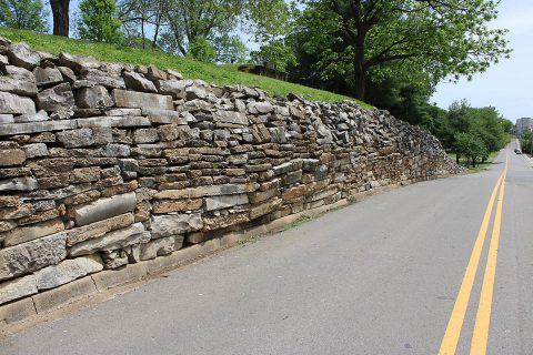 This failing old stone wall along Spring Street at Riverview Cemetery will be replaced in a project that begins June 1st.