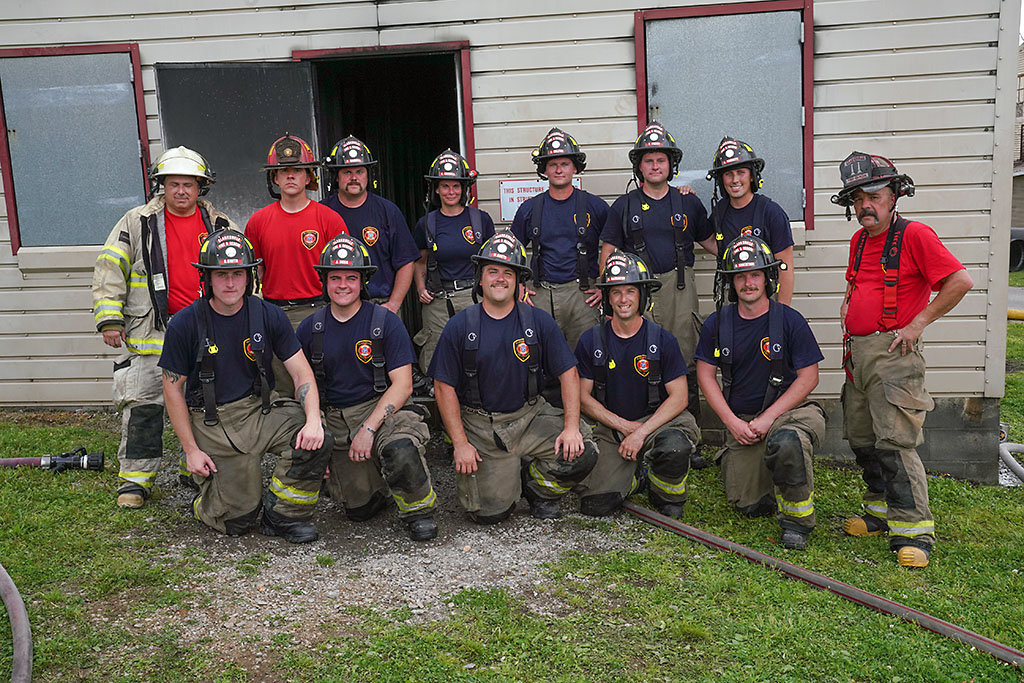 Clarksville Fire Rescue's new firefighters with training staff during Thursday's live-fire exercise.