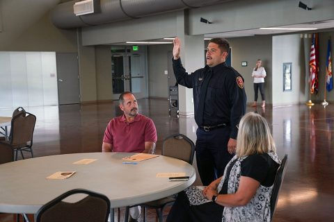 A new Clarksville Fire Rescue firefighter takes his oath during a ceremony Thursday at the Wilma Rudolph Event Center.