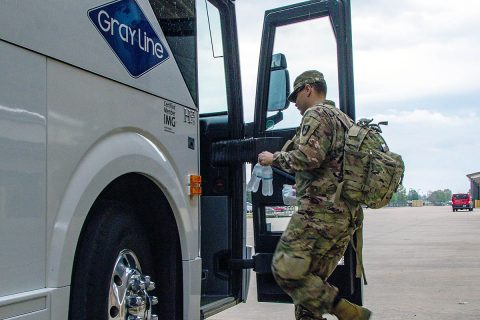 A Soldier assigned to the 212th Medical Detachment (Combat Operational Stress Control) boards a bus at Fort Campbell, Kentucky, the first step in a deployment to Afghanistan. About 10 Soldiers assigned to the 212th Medical Detachment deployed from Fort Campbell to Afghanistan in early May 2020 to provide medical support there. (U.S. Army photo by Pfc. Andrea Notter, 40th Public Affairs Detachment)