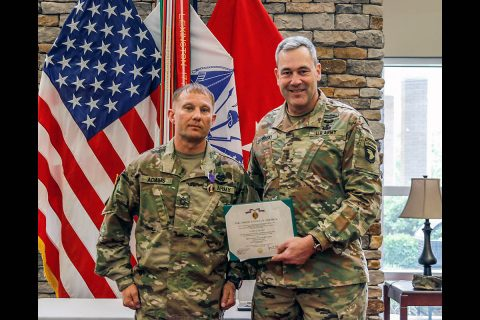 U.S. Army Sgt. 1st Class Leonard P. Adams, a Michigan National Guard flight medic with Detachment 1, Company C, 3-238th General Support Aviation Battalion in Grand Ledge, Michigan, was awarded the Purple Heart on May 5, 2020 in a small ceremony at Fort Campbell, Kentucky. (Courtesy photo)