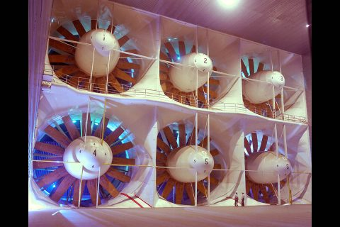 This system of fans moves air through the world's largest wind tunnels, at the National Full-Scale Aerodynamics Complex at NASA's Ames Research Center in California's Silicon Valley. Each of the six fans is 40 feet in diameter and is driven by a 22,500-horsepower electric motor. Two figures near fan 5 give a sense of scale. (NASA/Ames Research Center/Tom Trower)
