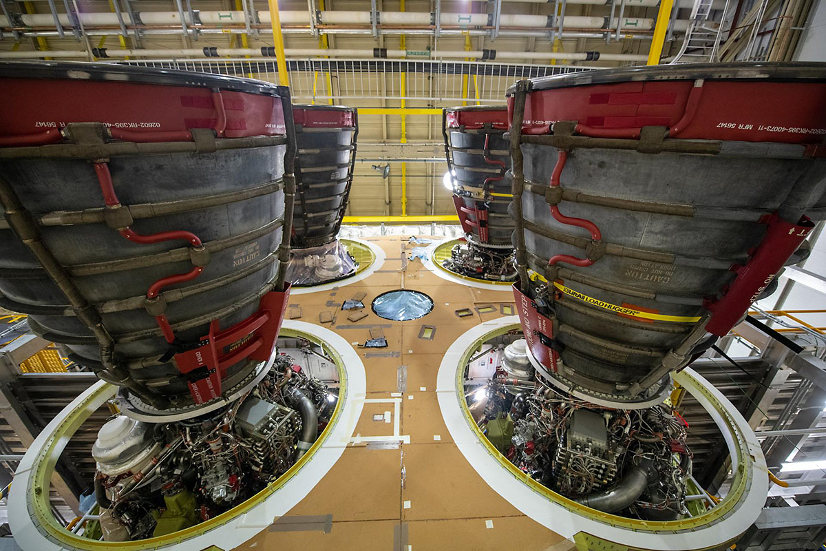 NASA has awarded a contract to Aerojet Rocketdyne of Sacramento, California, to manufacture 18 additional Space Launch System (SLS) RS-25 rocket engines to support Artemis missions to the Moon. The four RS-25 engines, shown here, are attached to the SLS core stage that will send the Artemis I mission to the Moon. Currently, the stage is undergoing a series of Green Run tests in a test stand at Stennis Space Center near Bay St. Louis, Mississippi. (NASA/Jude Guidry)