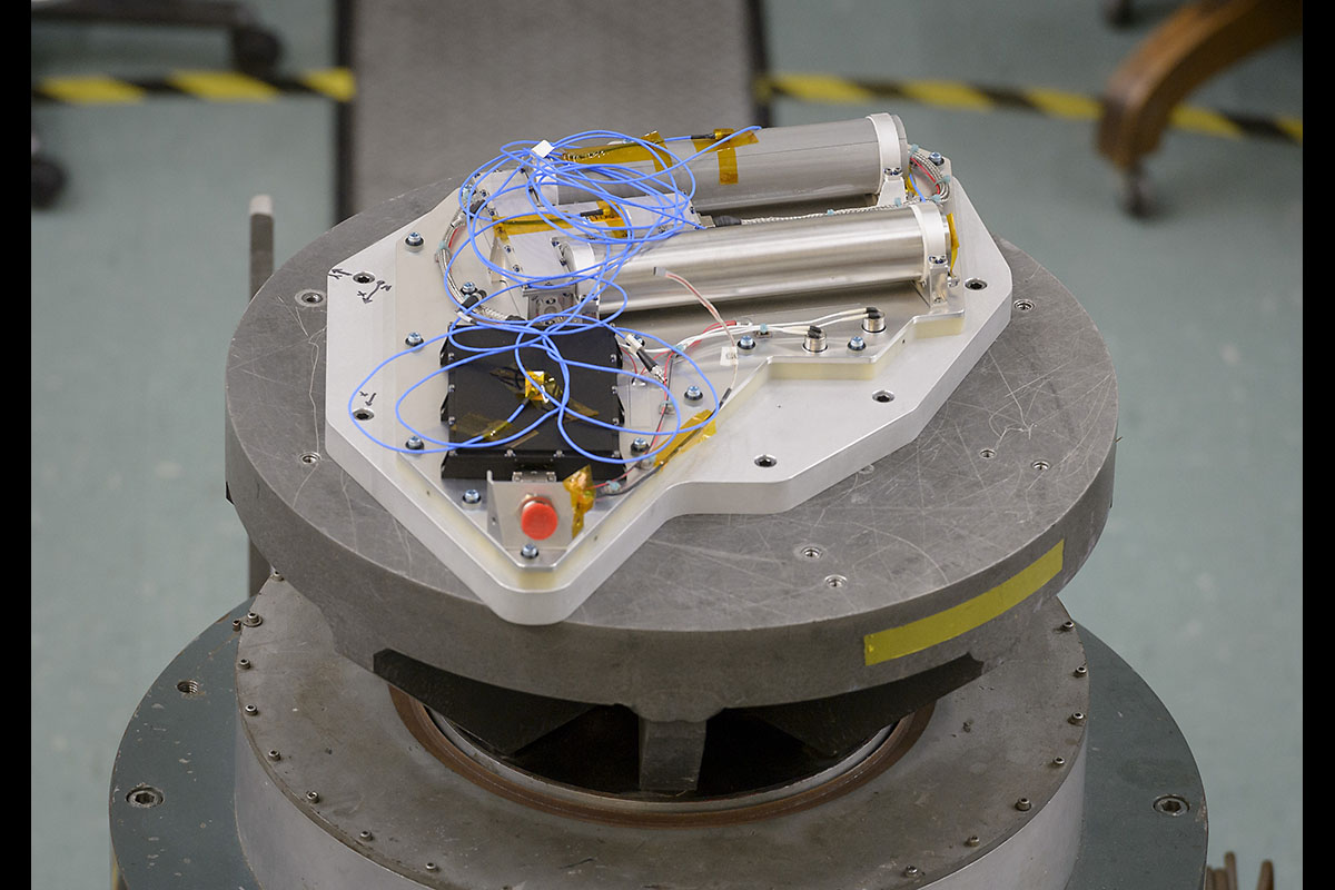 Researchers at NASA's Ames Research Center in California's Silicon Valley complete a successful vibration test of the Neutron Spectrometer System. This is one of the final tests needed to prepare the instrument for a flight to the Moon aboard Astrobotic Technology's Peregrine lander, as part of the agency's Commercial Lunar Payload Services program. (NASA / Ames Research Center / Dominic Hart)