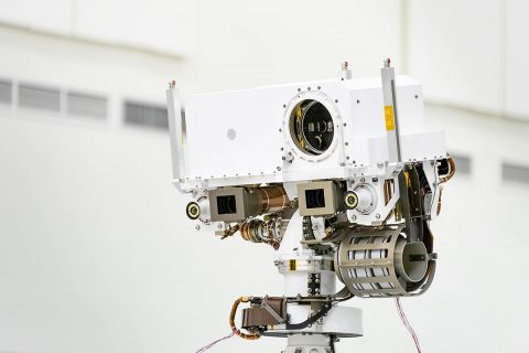A close-up of the head of Perseverance Rover's remote sensing mast. The mast head contains the SuperCam instrument (its lens is in the large circular opening). In the gray boxes beneath mast head are the two Mastcam-Z imagers. On the exterior sides of those imagers are the rover's two navigation cameras. (NASA/JPL-Caltech)