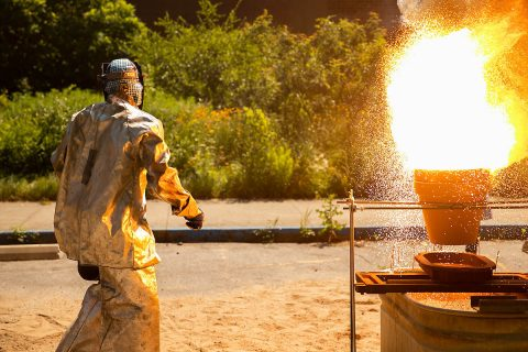 Austin Peay State University's Professional Mad Scientist Bryan Gaither steps away after igniting 1.3 pounds of thermite. (APSU)