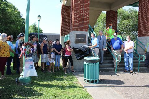 Ericka Prosecky, Clarksville Street Department Director David Shepard and Mayor Joe Pitts unveiled Monday a plaque to honor the memory of Jeffrey Prosecky Jr.