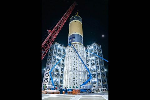 The liquid oxygen tank structural test article, shown here, for NASA's Space Launch System (SLS) rocket's core stage was the last test article loaded into the test stand July 10, 2019. The liquid oxygen tank is one of two propellant tanks in the rocket's massive core stage that will produce more than 2 million pounds of thrust to help launch Artemis I, the first flight of SLS and NASA's Orion spacecraft to the Moon.(NASA/Tyler Martin)