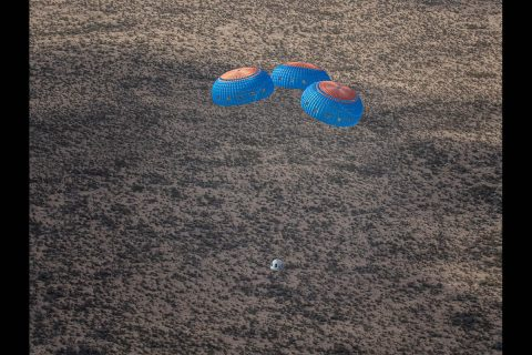 Capsule carrying NASA's Orbital Syngas/Commodity Augmentation Reactor (OSCAR) and other payloads parachutes to a safe landing after flight of Blue Origin's New Shepard suborbital rocket. (Blue Origin)