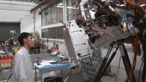 JPL engineers monitor testing of the Perseverance rover's Sample Caching System. (NASA/JPL-Caltech)