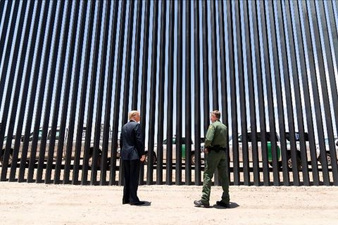 President Donald Trump visits the completed 200th mile of new border wall
