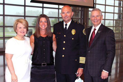 Clarksville Mayor Joe Pitts and Cynthia Pitts congratulate new Clarksville Police Chief David Crockarell and his wife, Lori, (center) after the swearing in ceremony Tuesday morning at the Wilma Rudolph Event Center. City officials and Clarksville Police also said farewell to retiring Chief Al Ansley.