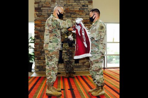 Fort Campbell Soldier Recovery Unit leaders, (from left) Command Sgt. Maj. Angel Rivera and Lt. Col. Heath Holt uncase the SRU colors. The Fort Campbell Warrior Transition Battalion was formally reflagged as the Fort Campbell Soldier Recovery Unit during a reflagging ceremony on Fort Campbell, July 10th. (U.S. Army)